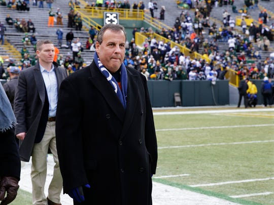 New Jersey Governor Chris Christie walks on the sidelines