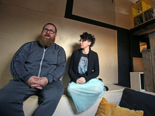 Ryan and Cheryl Marcus sit in their living room of their 240 square foot tiny home they built in Pomona Nov. 13, 2017.