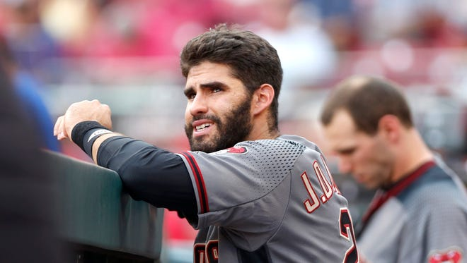 Jul 19, 2017: Arizona Diamondbacks right fielder J.D. Martinez watches from the dugout at the beginning of a game with the Cincinnati Reds at Great American Ball Park.