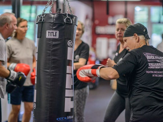 Participants learn to punch at Rock Steady Boxing,