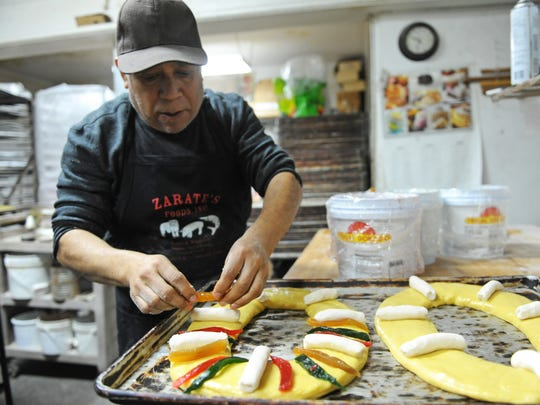 "Salvador Espinoza lays out a medium-size ""rosca de reyes"" pastry at Sal-Mex Bakery on Williams road in Salinas. His family-run enterprise has been in business for fourteen years."