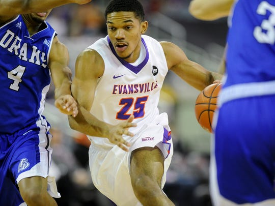 Evansville Aces guard Duane Gibson (25) drives down court between Drake Bulldogs guard De'Antae McMurray (4) and Drake Bulldogs guard Graham Woodward (3) during their game at the Ford Center in Evansville, Tuesday, Feb. 14, 2017. Evansville beat the Drake 87-70.