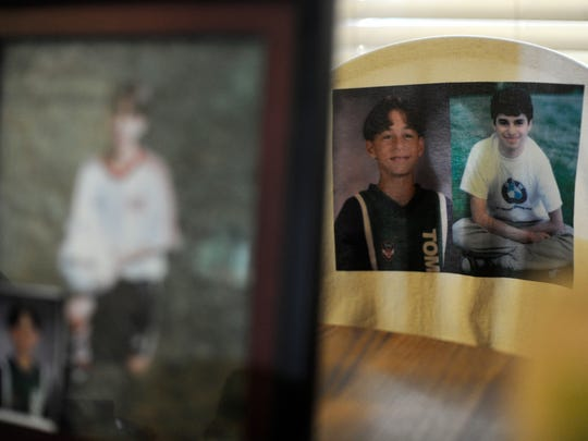 In this file photo from Sept. 1, 2010, pictures of Greg and Zach Witman adorn the kitchen table at the family home in New Freedom.