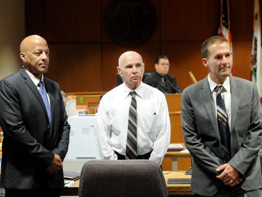 Senior Criminal Investigator Chas Wiggins, of the Ventura County Public Defender's Office, from left, Wilson Chouest, and Chief Deputy Public Defender Andre Nintcheff, wait for the jury to come into Ventura County Superior Court.