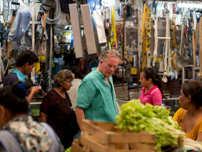 In this May 26, 2014 photo, American chef Jeremiah Tower shops vegetables at the Central Market in Merida, Mexico. Tower made his name in the '70s at Chez Panisse, the famed Berkeley, Calif., restaurant that helped spawn the renaissance of American cooking focused on fresh, local ingredients. Now Tower?s third act is underway in the capital of Yucatan, the tropical Gulf Coast state whose richly spiced, fat-laden and pork-heavy Mayan cuisine has produced what Tower calls a handful of world-class dishes.