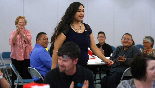 American Red Cross volunteer Leann Charlie heads to the podium, Thursday after being named Volunteer of the Year 2015 during the 25th Annual volunteer Recognition Awards and Service Learning Reception at San Juan College in Farmington.