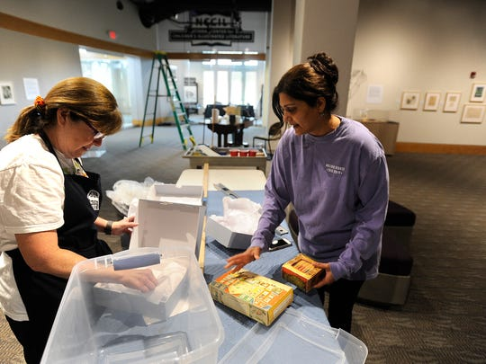 Debbie Lillick (left) and Sujata Shahane (right) take out the Tiny Animal Story books from the Tony Golden Library series on Friday, June 2, 2017, at the National Center for ChildrenÕs Illustrated Literature. The book are part of the Garth Williams exhibit which opens on June 8.