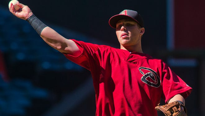 Brandon Drury throws during instructional league play at Chase Field against the Oakland Athletics in Phoenix.