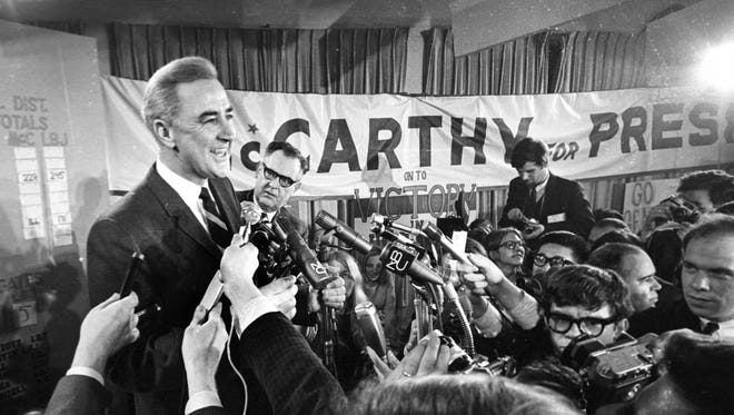 Sen. Eugene McCarthy, D-Minn., is shown in this March 12, 1968, photo as he talks to campaign workers and the press at his Bedford, N.H. campaign headquarters.