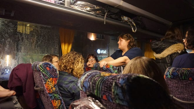 A coach bus filled with 54 women from in and around Cincinnati prepare to make the 10-hour trip to Washington, D.C. to participate in the Wlomen's March on Washington on Jan. 21, 2017