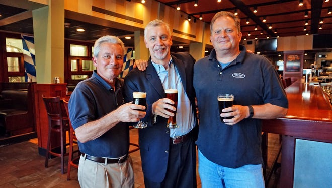 Iron Hill Brewery & Restaurant founders (from left) Kevin Davies, Kevin Finn and Mark Edelson. The trio will expand their brewery and restaurant concept to South Carolina.