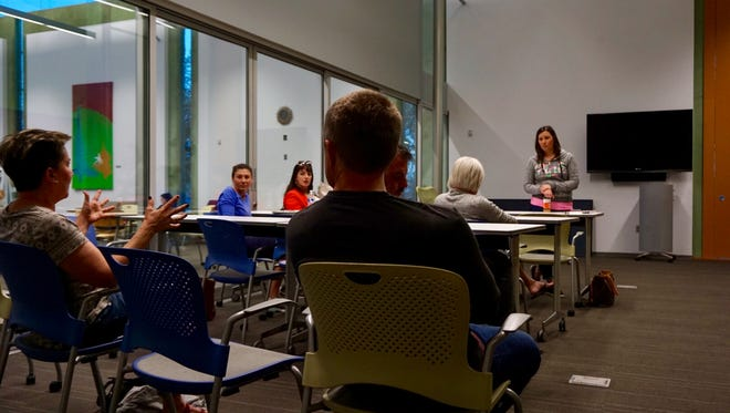 Upper West Side PHX founder Katie Roe, right, listens to member suggestions at a small community meeting in Sunrise Mountain Library on March 6, 2018.