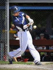 Luxemburg's Cory Wenz hits a double and drives one