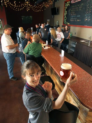 Business co-owner Dayna Tran offers up a variety of custom brews at Eternity Brewing in Genoa Township.