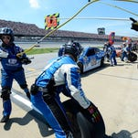 Dale Earnhardt Jr. (88) makes a pit stop during the Talladega 500 NASCAR Sprint Cup Series auto race at Talladega Superspeedway, Sunday in Talladega, Ala