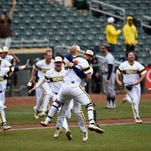Michigan catcher Kendall Patrick, front, and closing pitcher Jacob Cronenworth celebrate a win in the Big Ten Tournament championship game against Maryland, Sunday in Minneapolis. Michigan won 4-3.