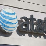 (FILES) AT&T has been fined $100 million by the FCC for its unlimited data plan disclosure policy.  AFP PHOTO / SAUL LOEB / FILESSAUL LOEB/AFP/Getty Images ORG XMIT: AT&T to b ORIG FILE ID: 537170060