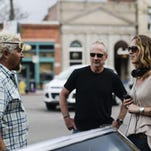 A camera crew works with Food Network's Guy Fieri during his April 23 visit to Old Town Fort Collins. 'Diners, Drive-Ins and Dives' will feature two Fort Collins restaurants in episodes airing in August and September.