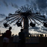 People ride the 'YOYO' at the Larimer County Fair, Friday, July 31, 2015, in Loveland, Colo.