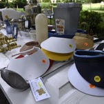 Sonia Meador looks through items at a multifamily yard sale to help the Lake Forest Acres Garden Club pay for a historical marker on Aug. 7 in Nashville.