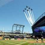 150729-N-SN160-012 SEATTLE (July 29, 2015) The U.S. Navy Flight Demonstration Squadron, the Blue Angels, fly over Safeco Field before a Seattle Mariners baseball game. The Blue Angels are scheduled to perform at the Seafair Air Show on Aug. 1st and 2nd. (U.S. Navy photo by Mass Communication Specialist 1st Class Michael Lindsey/Released)