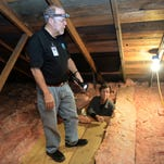 Bill Jenkins looks on as Mark Fagerburg conducts an energy audit to help Jenkins and his wife Barbara Liebler make their home more efficient on Thursday, November 19, 2015. The City of Fort Collins wants to reduce its carbon dioxide emissions by 20 percent of 2005 levels by 2020.