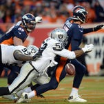 Oakland Raiders defensive end Khalil Mack (52) strip sacks Denver Broncos quarterback Brock Osweiler (17) in the end zone in the third quarter at Sports Authority Field at Mile High on Dec. 13.