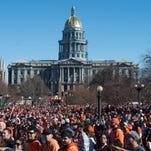 Broncos fans gather in Civic Center Park during a Super Bowl championship celebration in Denver Tuesday, February 9, 2016.