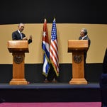 Cuban President Raul Castro points to a member of the U.S. media who had asked a question during a joint news conference with President Barack Obama at the Palace of the Revolution, Monday.