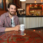 Patrick McGuire preparers a cappuccino at  the Poughkeepsie Grind on Main Street in the City of Poughkeepsie on Thursday.  McGuire plans to open his new coffee shop over Memorial Day weekend.