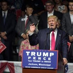 Presidential candidate Donald Trump speaks Wednesday at a rally at the Mississippi Coliseum in Jackson. Trump vowed to continue to take a hard line on illegal immigration.