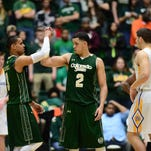 CSU's Gian Clavell, left, congratulates teammate Daniel Bejarano near the end of the Rams' 72-56 win Wednesday over San Jose State at Moby Arena.