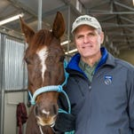 Colorado State University Clinical Sciences professor Patrick McCue poses with a horse in January 2015.
