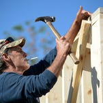 A construction employee works in February on the redevelopment of a shopping plaza at U.S. 41 and Island Park Road in south Fort Myers. Area builders and others in construction-related businesses are having a hard time finding enough qualified workers.