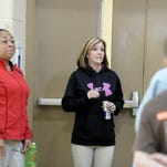 Joyce Gray, left, and Casey Dollin talk with students at Wernle Youth and Family Treatment Center in Richmond.