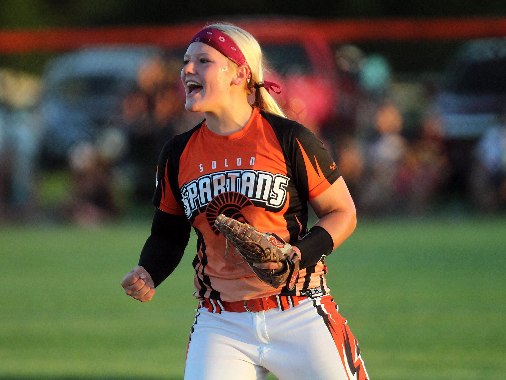 Solon's Ali Herdliska celebrates a strikeout during the Spartans' Class 3A regional championship against PCM, Monroe in Grinnell on Monday, July 13, 2015. David Scrivner / Iowa City Press-Citizen