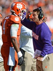 Clemson head coach Dabo Swinney congratulated quarterback Deshaun Watson (4) after he scored against South Carolina during the 2nd quarter Saturday, November 29, 2014 at Clemson's Memorial Stadium.