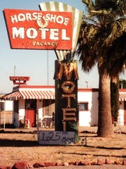 A neon sign from Casa Grande's Horseshoe Motel will