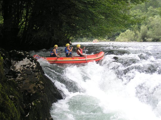 Anderson University students go white-water rafting down a river that separates Croatia and Slovenia during a study abroad trip in 2015.