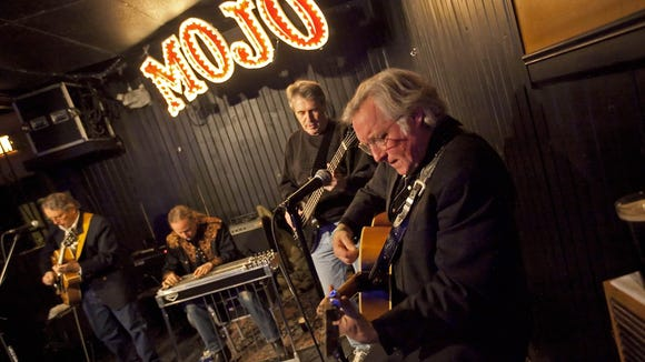Steve Hobson (far left) and Scott Birney (far right) performing on a Monday night at Mojo Main in 2011.