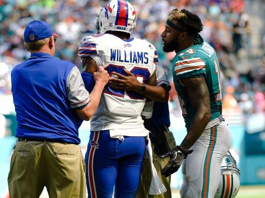 Jarvis Landry apologizes to former Bills safety Aaron Williams after a vicious blow to the head in a game last year in Miami.