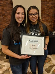 Jennifer Han, International Boxing Federation World Champion, left, led the El Paso delegation to the All-America City Awards presentation. She stands with 14-year-old El Pasoan Aileen Martinez, who won the All-America City Youth Leadership Award.