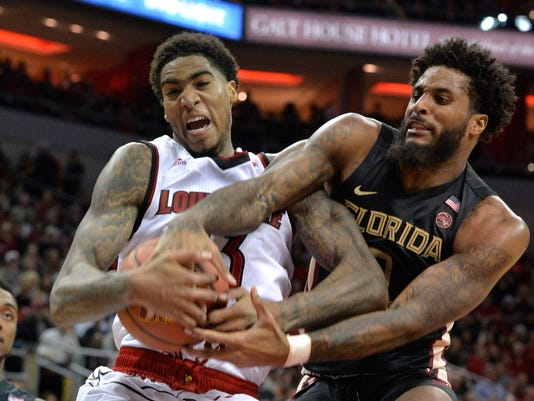 FILE- In this Feb. 3, 2018, file photo,  Florida State forward Phil Cofer, right, battles Louisville forward Ray Spalding (13) for a rebound during the second half of an NCAA college basketball game in Louisville, Ky. Cofer is hoping that Saturday's game won't be his final home game. The senior forward, who is one of the most improved players in the Atlantic Coast Conference this season, has petitioned the NCAA for a fifth season after a foot injury mostly wiped out his sophomore season. (AP Photo/Timothy D. Easley, File)
