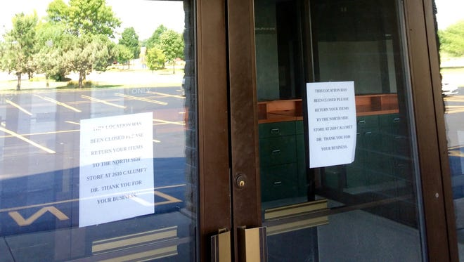 Signs have been hung in the window of the south-side Family Video alerting customers that the store has closed.