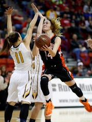 Cedarburg's Ady Schreiner, right, gets past the defense of Pius XI's Jordyn Zadar in the first half of the Division 2 finals.