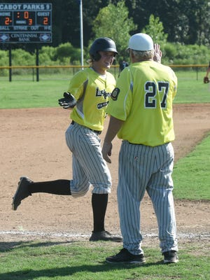 Mountain Home's Luke Dibble gets a high-five from head coach Lester White after clubbing a three-run home run in the Lockeroom's 5-2 win over Batesville on Saturday at Cabot.