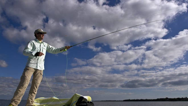 Outdoors writer Jack Ballard, of Red Lodge, Montana, casts with his fly-fishing rod on one of the prettier days in January. He visited  Captiva Island and Pine Island Sound as part of an Outdoor Writers Association of America meeting.