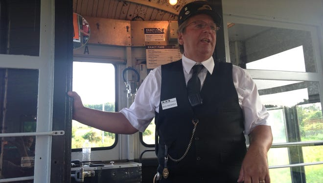Rich Fischpera of the New York Museum of Transportation talks to trolley riders at Trolleys at Twilight in Rush on July 11, 2015.
