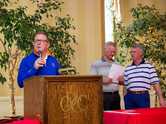 Scott Hartman, president and CEO of Rutter's Farm Stores, delivers a speech during a dinner and awards ceremony on May 3. He is accompanied by Todd Rutter, president of Rutter's Dairy, and Tim Rutter, president of M&G Realty.
