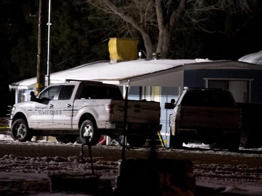 Grant Louis Biedermann was found guilty of two counts of aggravated assault for the 2013 shooting of an Iron County Sheriff's deputy. In this file photo, law enforcement vehicles sit outside the scene of the officer involved shooting.